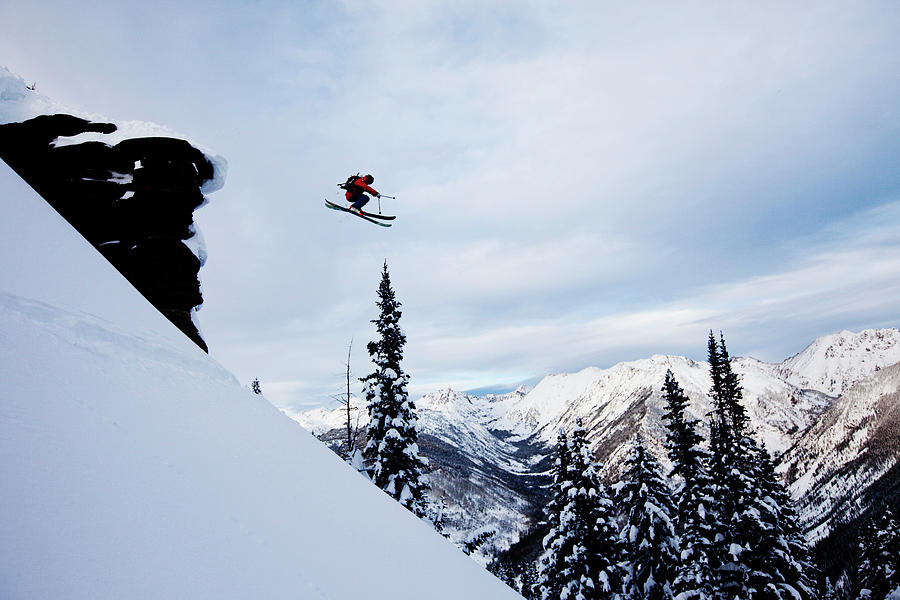 A Athletic Skier Jumping Off A Cliff In Photograph by Patrick Orton