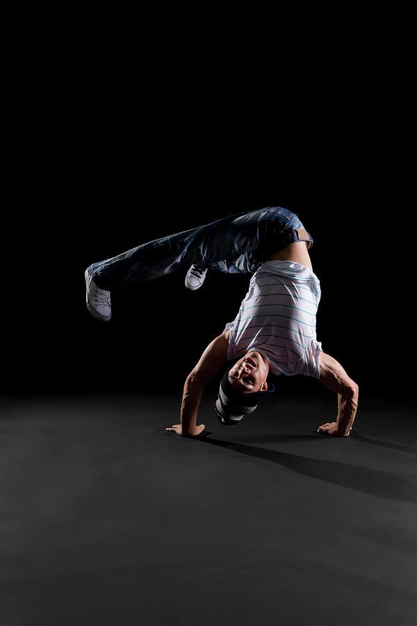 A B-boy Doing A Handstand Freeze Photograph by Halfdark