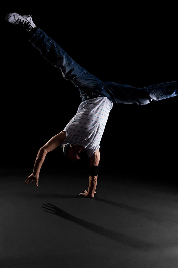 A B-boy Doing A One-handed Freeze Photograph by Halfdark