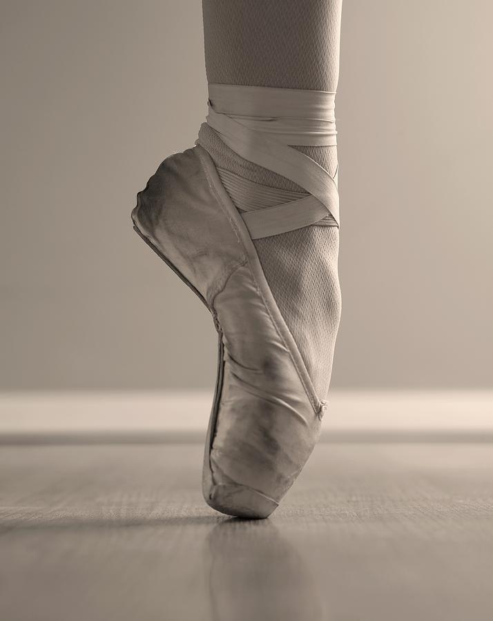 A Ballerinas Foot En Pointe Photograph by Tetra Images
