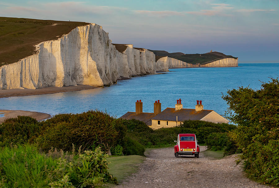 A Beautiful Sunset At Seven Sisters Cliffs In England With A Red Car Passing By Photograph