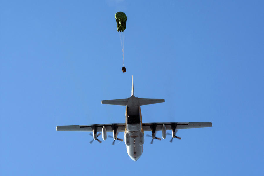 Horizontal Photograph - A C-130e Releasing Airborne Loads by Daniele Faccioli