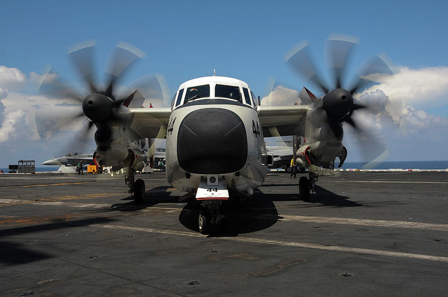 Military Photograph - A C-2a Greyhound Taxis The Flight Deck by Stocktrek Images