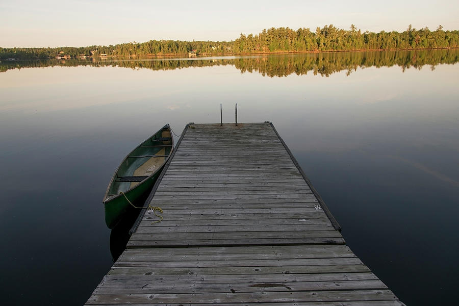 A Canoe Tied To A Wooden Dock On A Photograph by Keith Levit / Design Pics