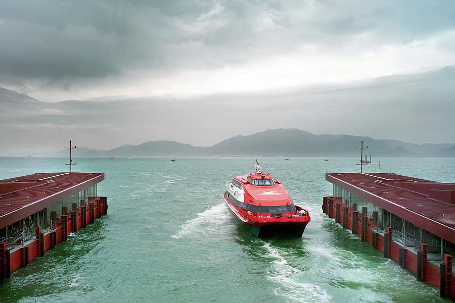 A Catamaran Ferry Docks At A Port Photograph by Xpacifica