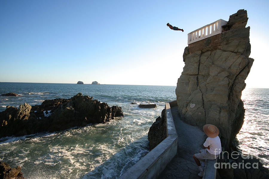 Shadow Photograph - A Cliff Diver Plunges Into The Pacific by Robcocquyt