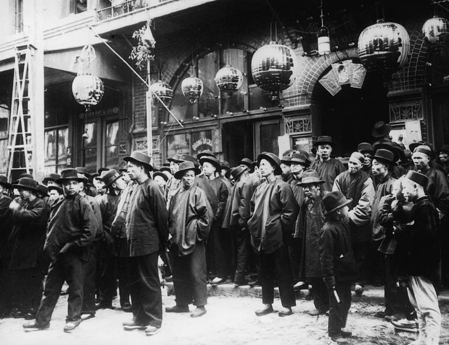 A Crowd Of Men On The Street In Photograph by Fpg