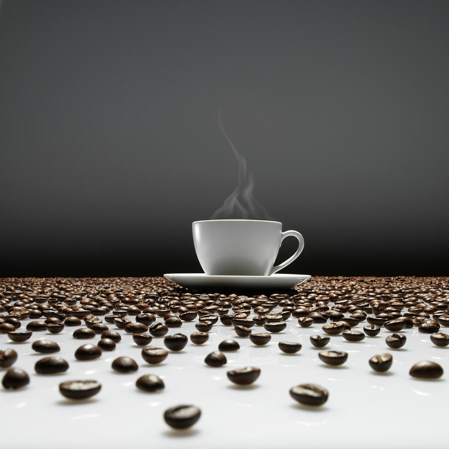 A Cup Of Coffee Sitting In The Middle Photograph by Jostaphot