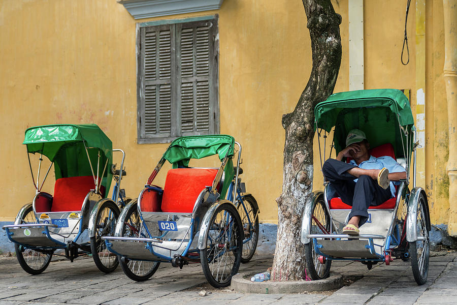 Asia Photograph - A Cyclo Driver Takes A Nap, In Hoi An, Vietnam. by Ian Robert Knight