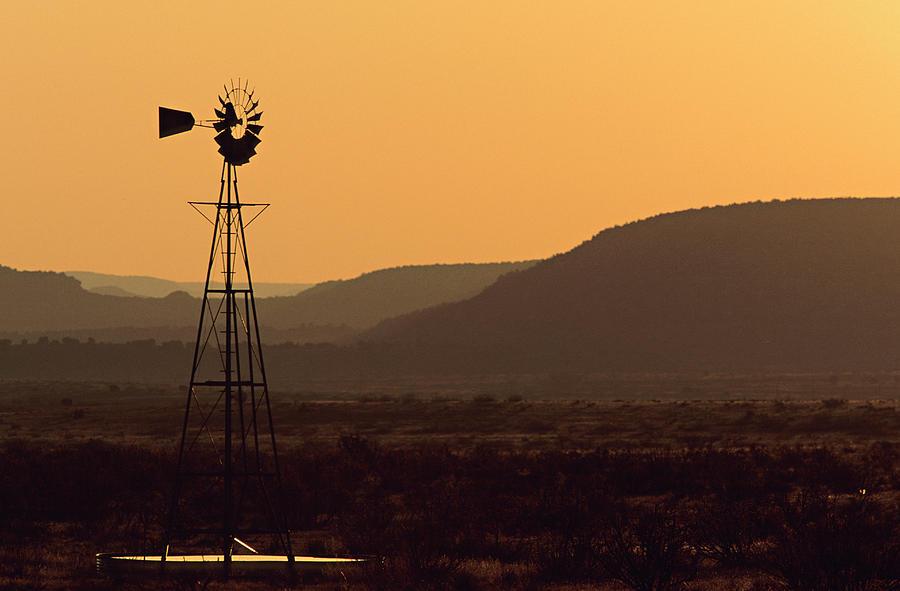 A Desert  Windmill At Sunset Photograph by Wesley Hitt