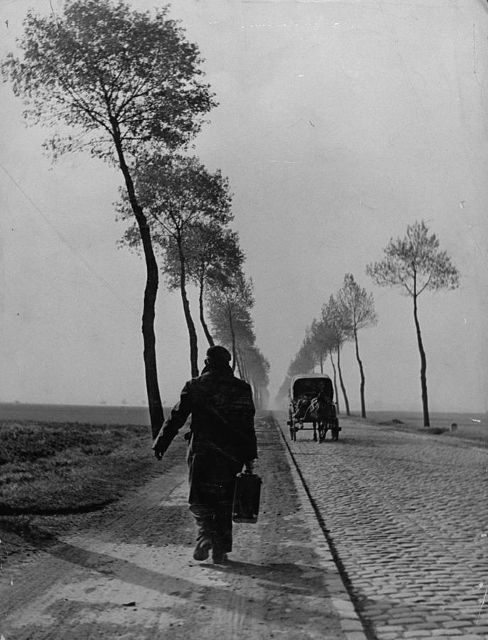 A Displaced Person Returning Home From A Photograph by Ralph Morse