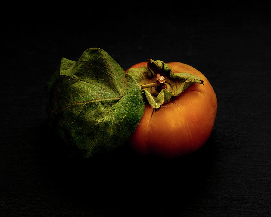 A fall harvest persimmon  by Alessandra RC