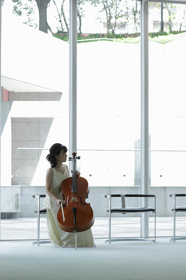 A Female Cellist Making Herself At Home Photograph by Sot