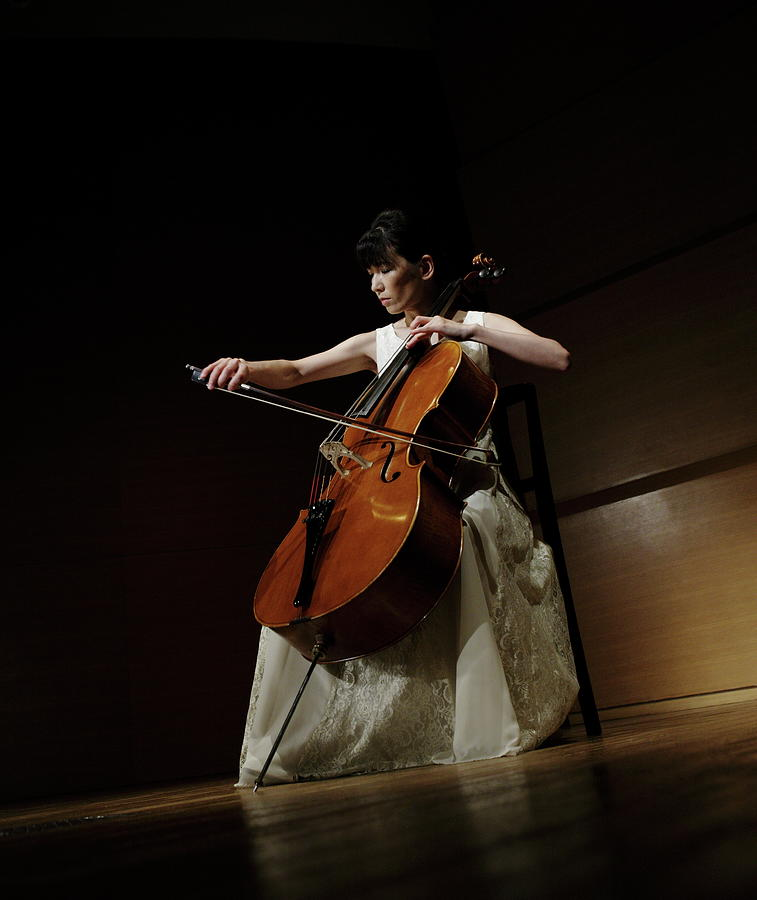 A Female Cellist Playing Cello On Stage Photograph by Sot