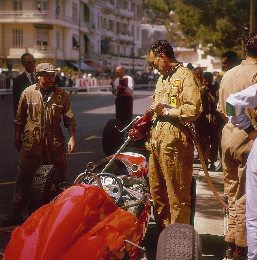 A Ferrari Team Member Filling A Car Photograph by Heritage Images