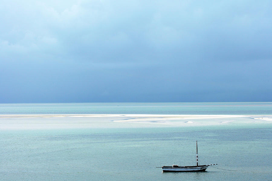 A Fishing Dhow Anchored Of The Coast Of Photograph by Oliver Strewe