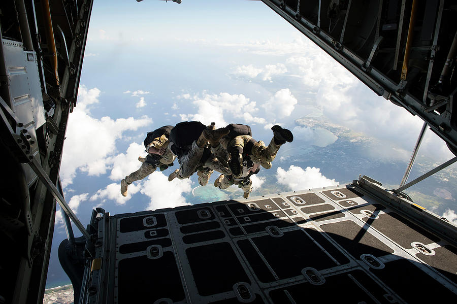 Guam Photograph - A Free Fall Jump From A C-130 Hercules by Stocktrek Images