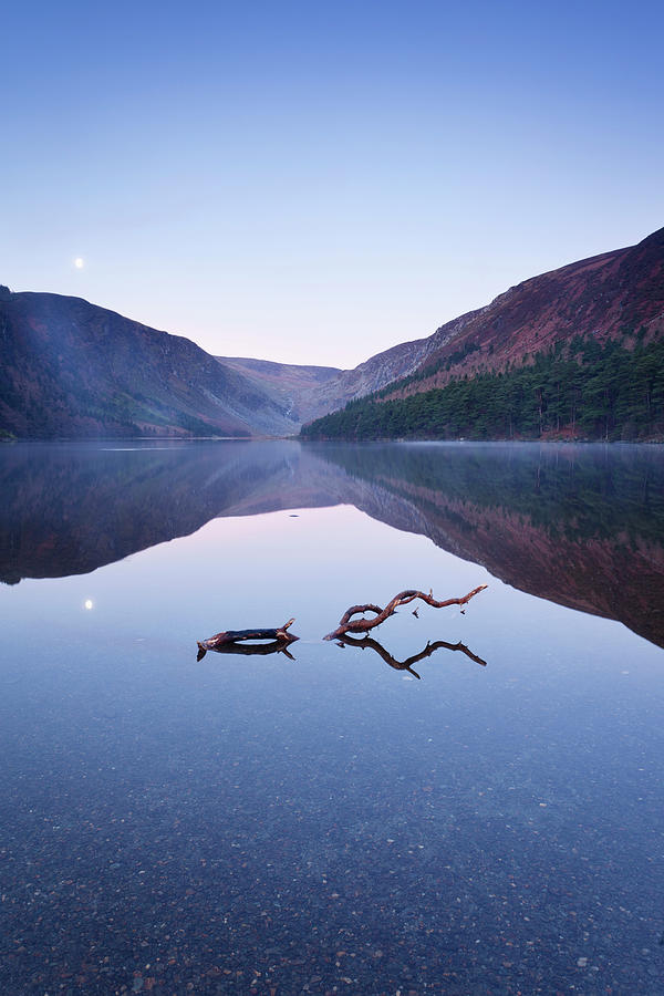 Tranquility Photograph - A Full Moon Reflecting In The Calm by Peter Mccabe / Design Pics