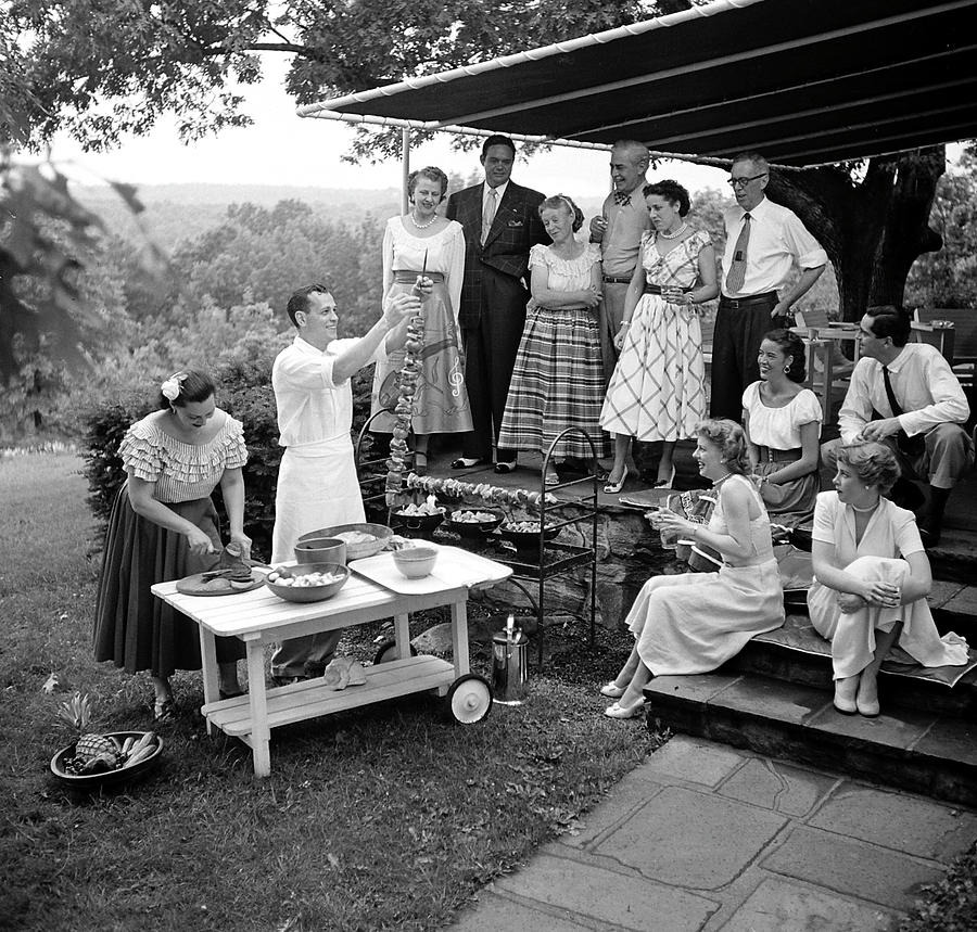 A Gathering Of Well Dressed Guests At A Photograph by Nina Leen