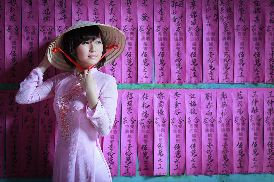 A Girl In A Pink Ao Dai And A Non La Photograph by Jethuynh