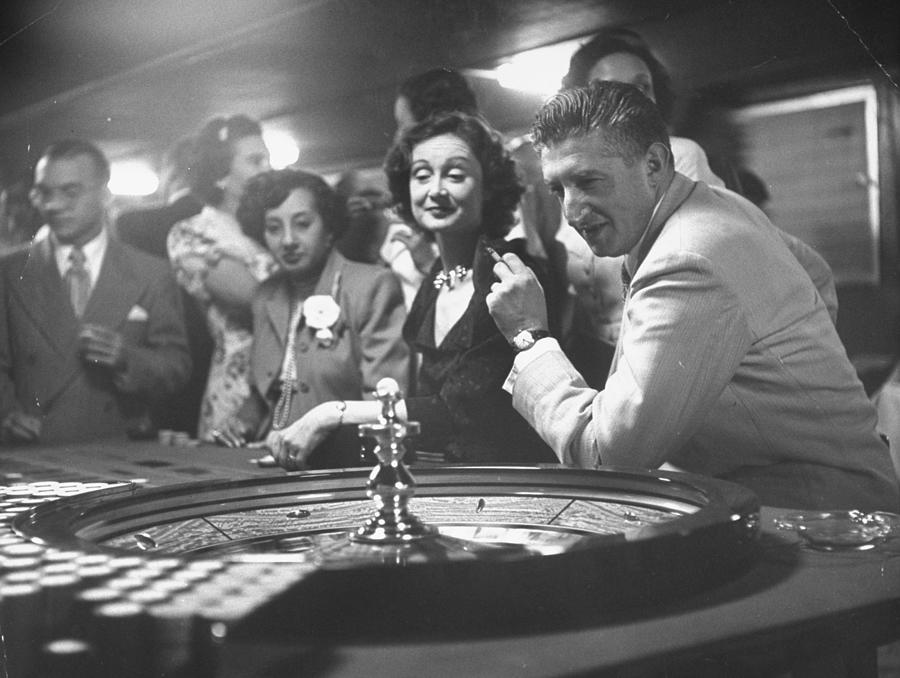A Group Of People Gambling At A Roulette Photograph by Gordon Parks