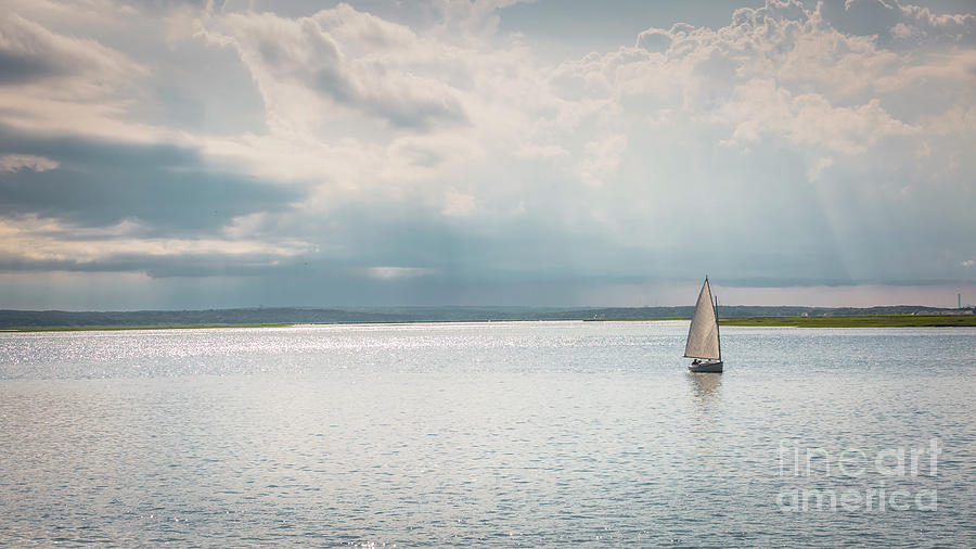 A lonely sailboat by Agnes Caruso