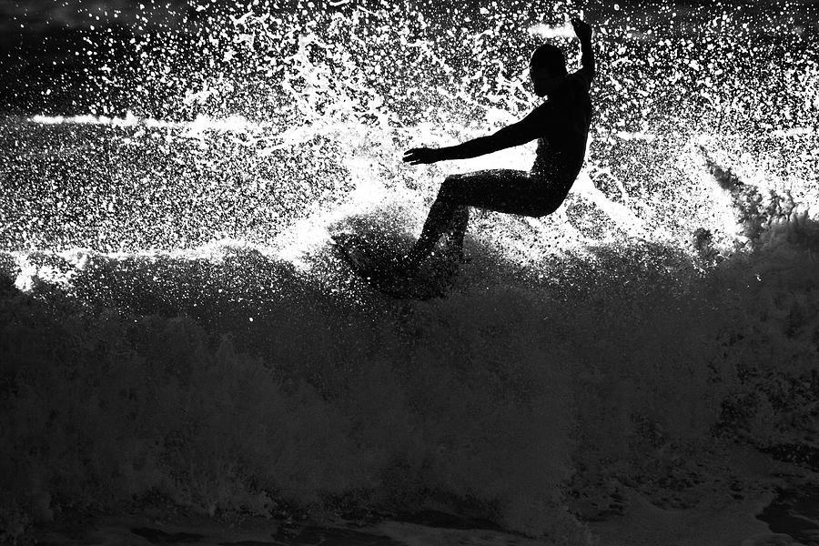 A Male Surfer Does A Floater Over A Photograph by Kyle Sparks