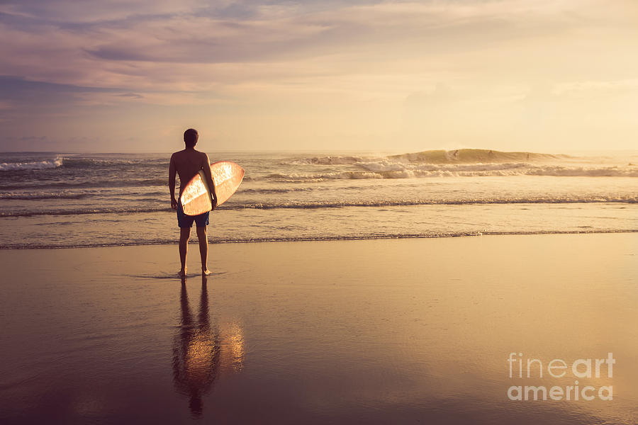 Surfing Photograph - A Man Is Standing With A Surf In His by Mariia Smeshkova