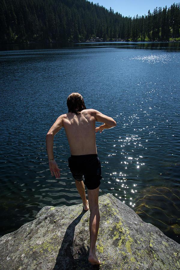 Washington Photograph - A Man Jumps Into An Alpine Lake by Jaime Boddorff