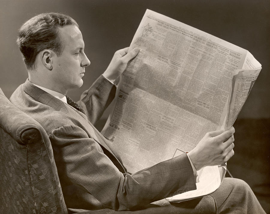 A Man Reads A Newspaper Photograph by George Marks