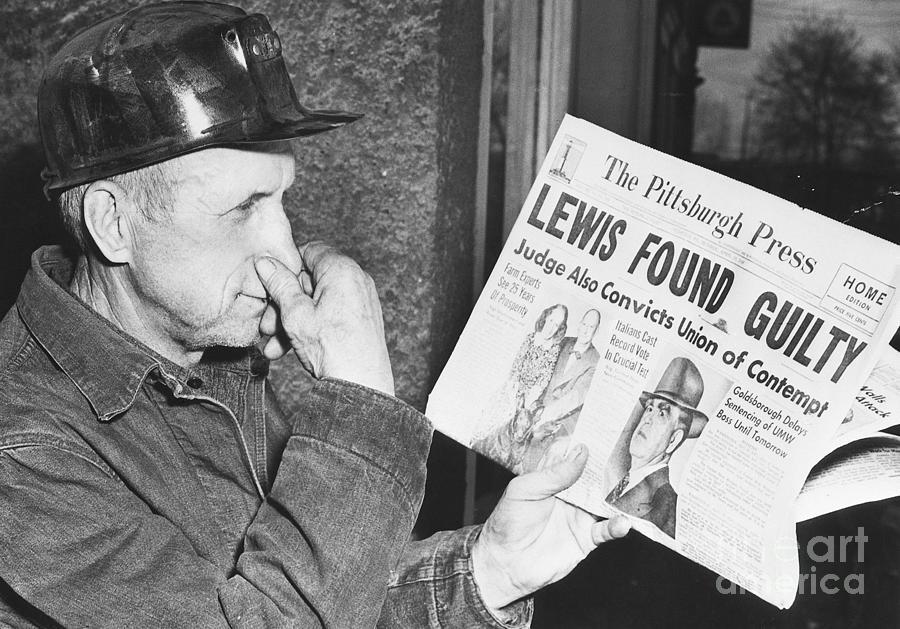 A Miner Reacts To A Newspaper Headline Photograph by Bettmann