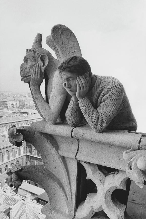 Model Beside Notre Dames Gargoyle Le Penseur Photograph by Reid Miles