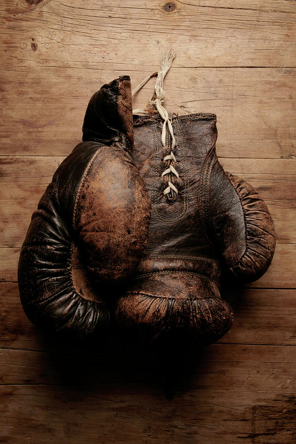 A Pair Of Worn Old Boxing Gloves On Photograph by The flying dutchman