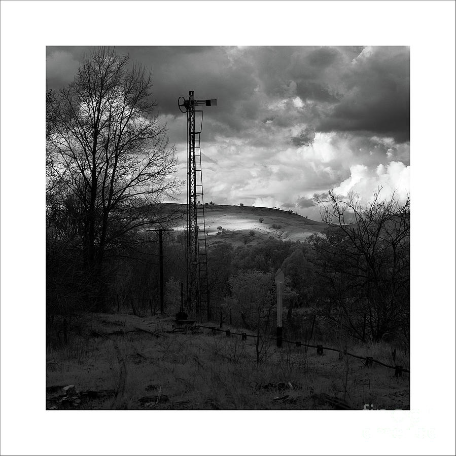 A patch of light on a distant hill by Russell Brown