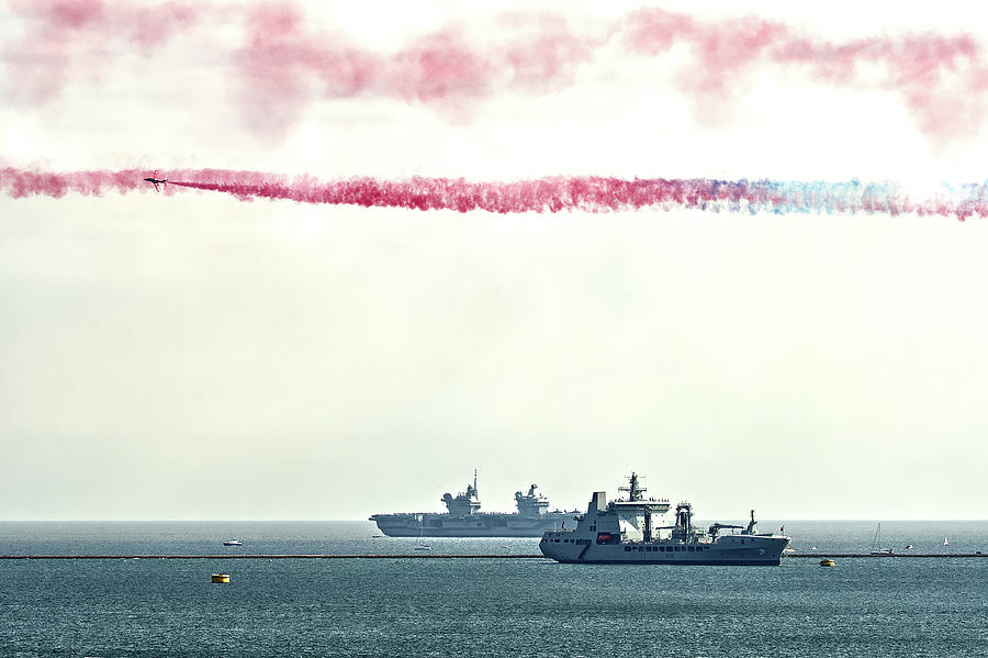 Red Arrows Photograph - A Red Arrow Over Plymouth Sound by Chris Day