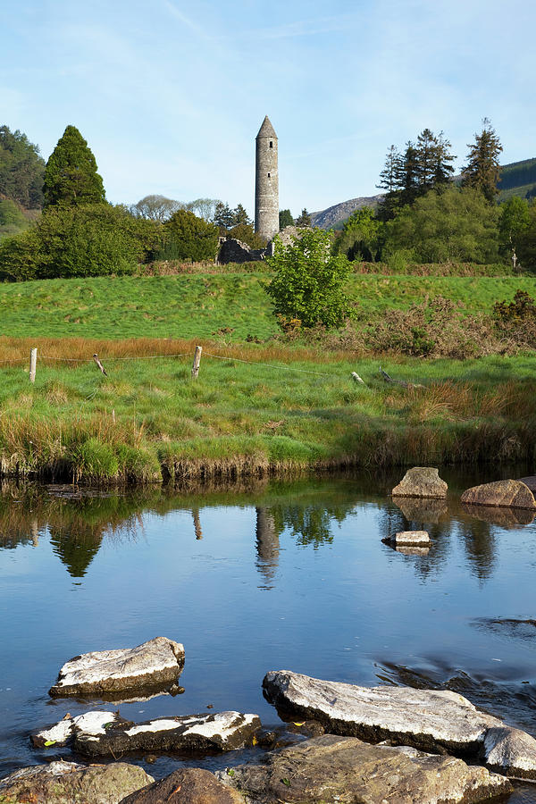 Tranquility Photograph - A Round Tower With The Reflection In A by Peter Zoeller / Design Pics