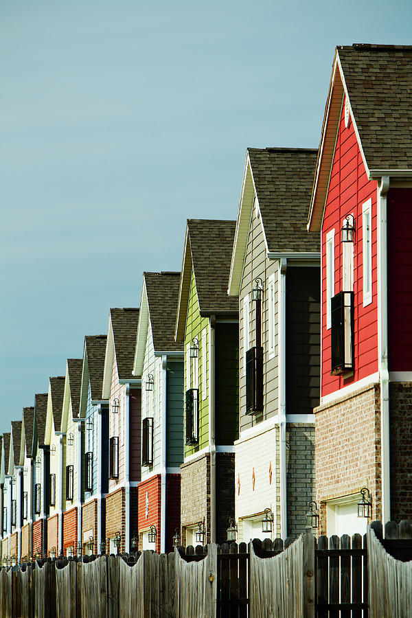A Row Of Colorful Suburban Homes Photograph by Wesley Hitt