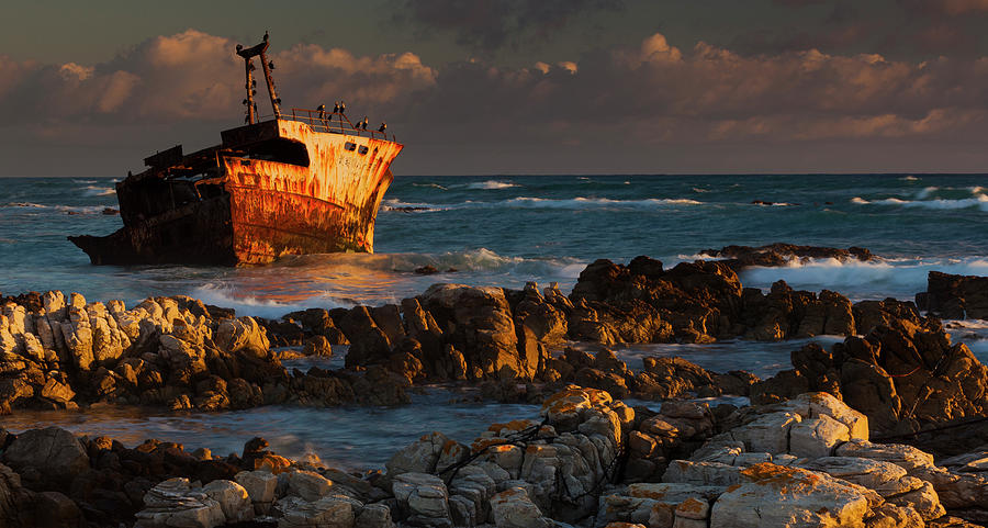A Rusting Wreck, An Abandoned Ship Off Photograph by Mint Images - Art Wolfe