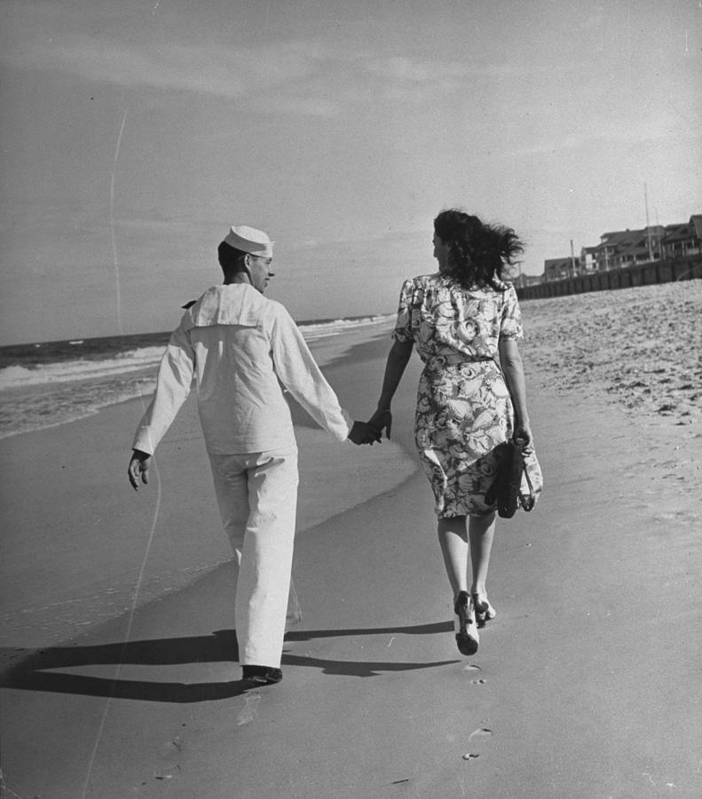 A Sailor And His Date Taking A Walk Alon Photograph by William C. Shrout