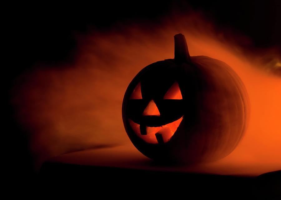 A Scary Halloween Pumpkin In Smoke Photograph by Ilonabudzbon