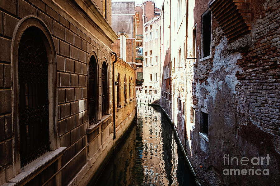 A shadow in the venetian noon narrow canal by Marina Usmanskaya