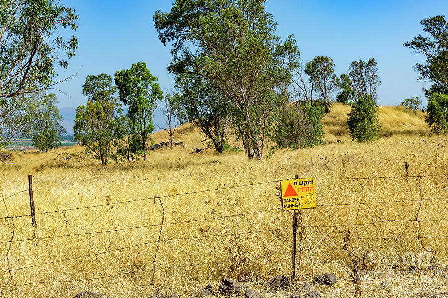 A sign warns of uncleared mines in the Golan Heights, Israel. A  by William Kuta