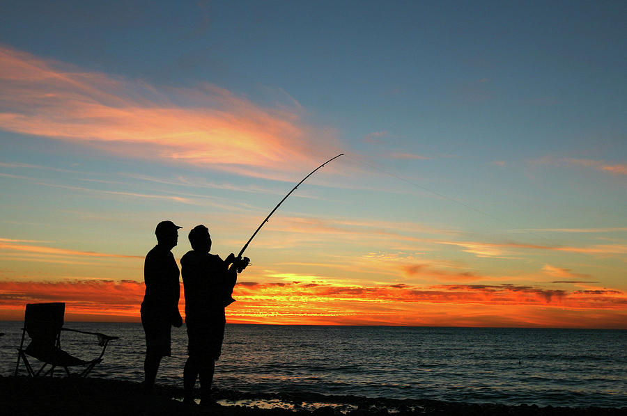 A Silhouette Of Two Men Fishing At Photograph by Jamesbowyer