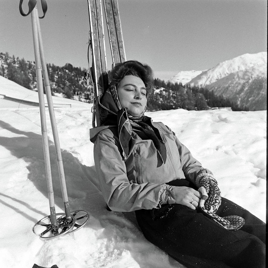 A Skier Rests In The Sun Beside Her Photograph by Alfred Eisenstaedt