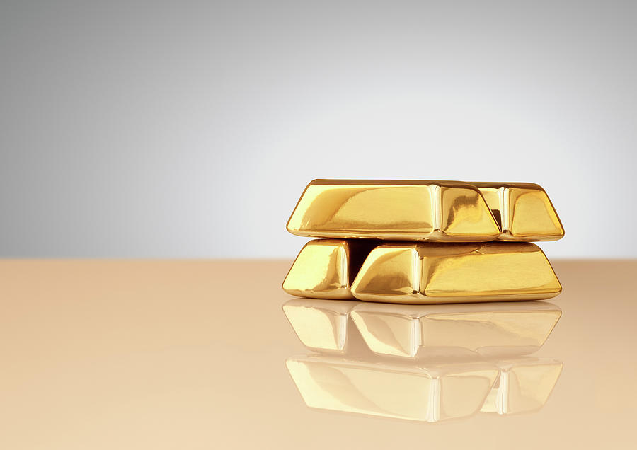 A Stack Of Four Gold Ingots Photograph by Anthony Bradshaw