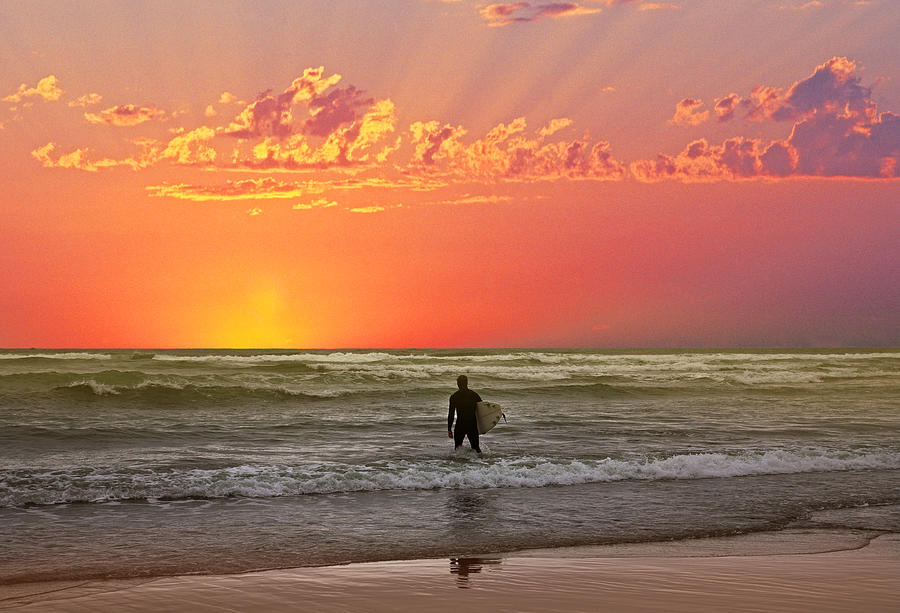 A Surfer On A Pacific Ocean Beach At Sunset Photograph