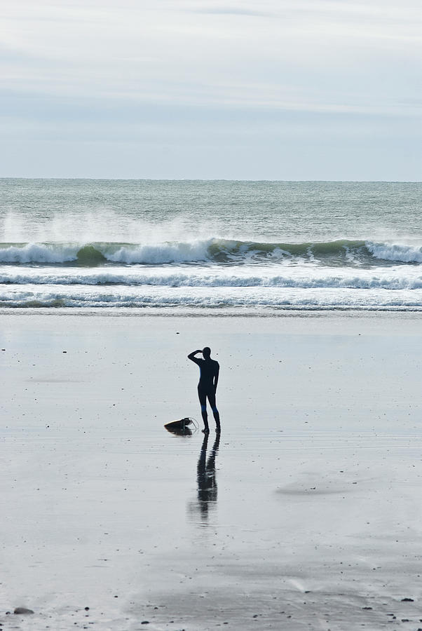 A Surfer Watches The Waves Before Photograph by Mark Marchesi