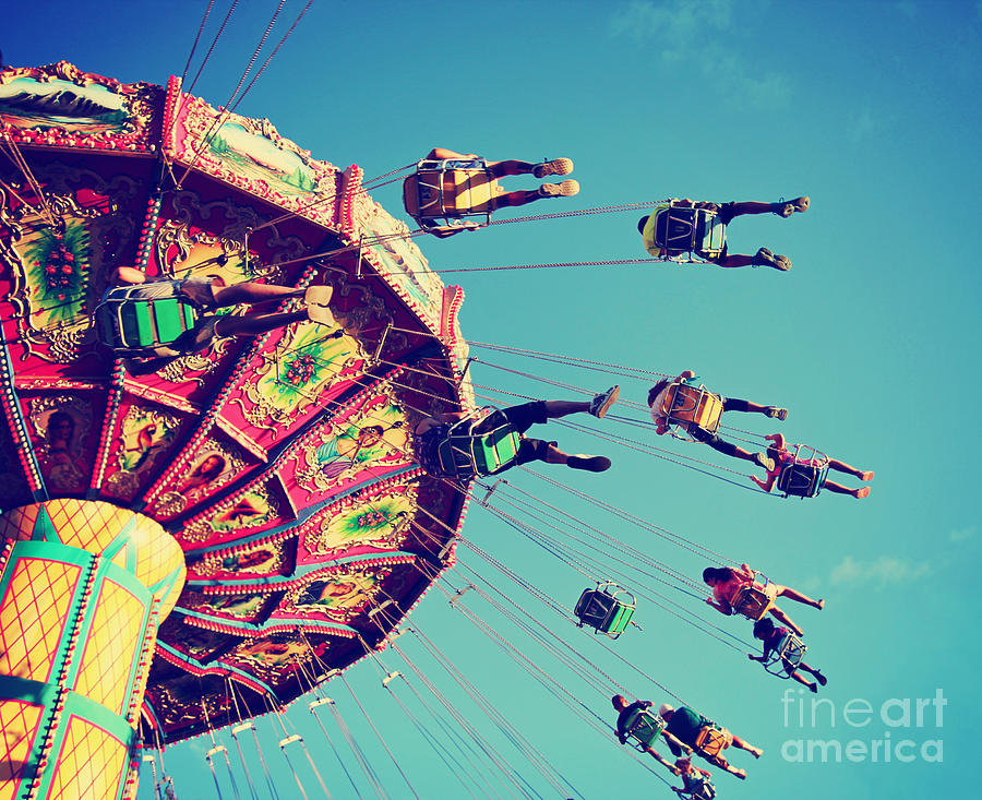 Play Photograph - A Swinging Fair Ride At Dusk Toned With by Annette Shaff