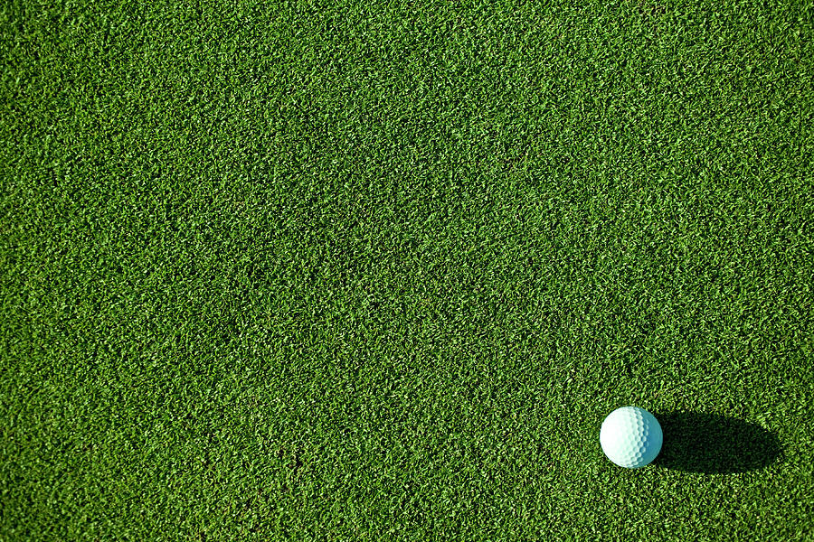 A White Golf Ball On Pristine Green Photograph by Love life