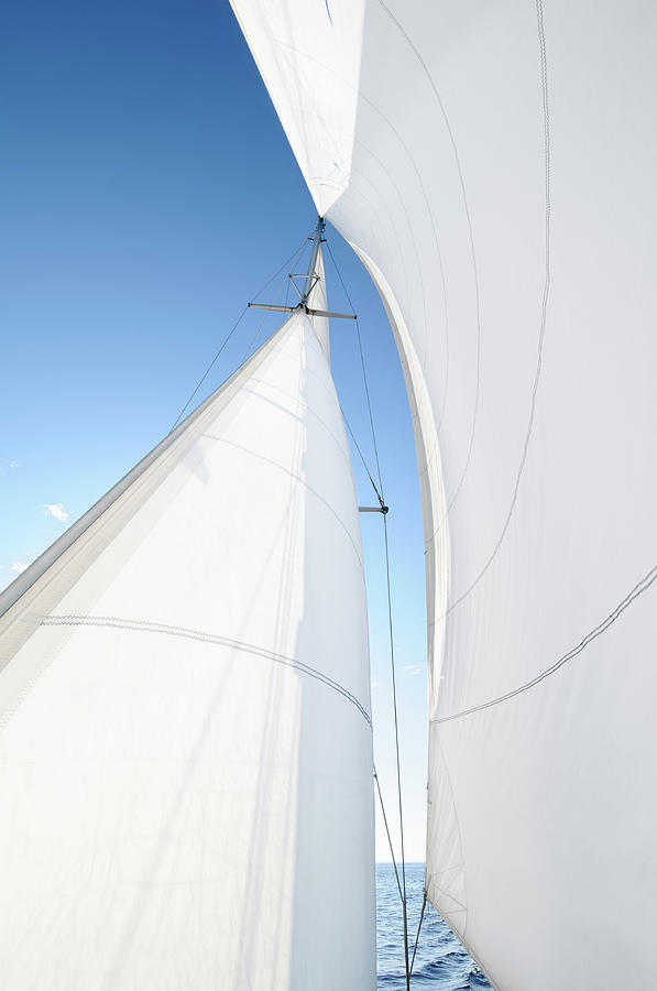 A White Sail Being Blown By The Wind Photograph by Nikitje